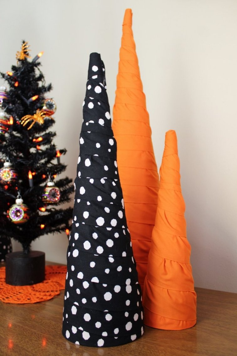 Orange, black and white cone trees in a Halloween display