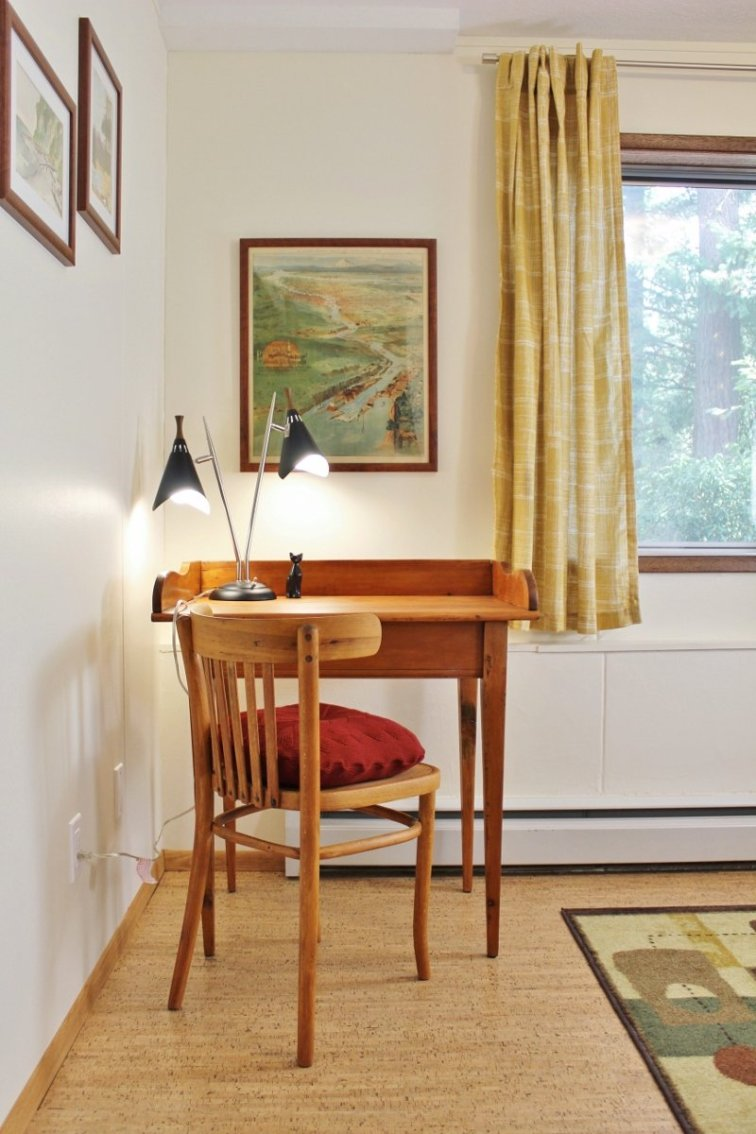 Mid-century desk in travel-themed guest room