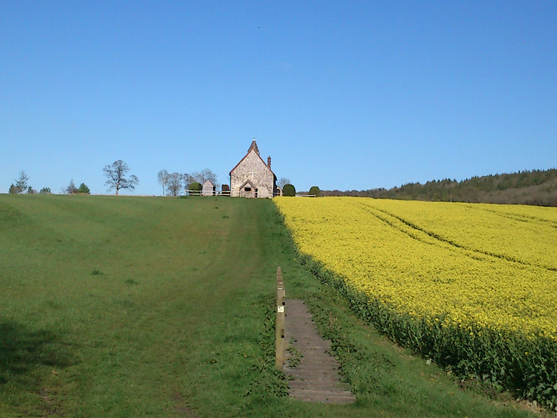 Church set off road in field possibly site of a plague village