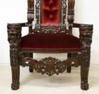 A GOTHIC LION KING THRONE CHAIR in mahogany and red velvet ...