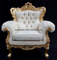 A Shaadi Sofa and Two armchairs in Gold and Cream / Ivory
