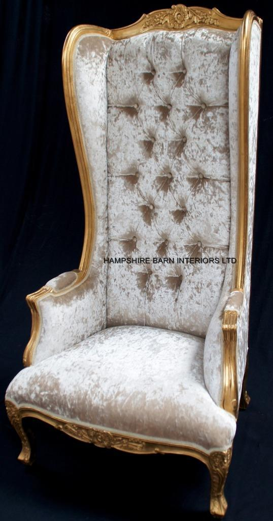 A Gold Ornate High Back Porters Arm Chair In Gold Leaf And