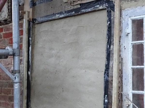 Wattle daub panels repair in progress
