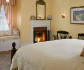bed and breakfast with fireplace in room