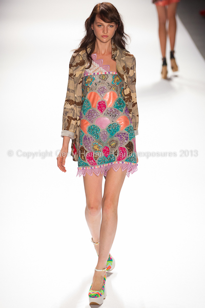 A model on the runway at the Custo Barcelona SS2013 show at New York Mercedes-Benz Fashion Week.