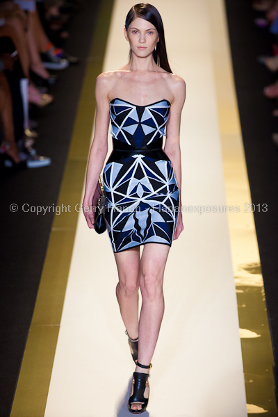 A model on the runway at the Herve Leger SS2013 show at New York Mercedes-Benz Fashion Week.
