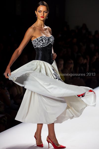A model on the runway at the Norisol Ferrari SS2013 show at New York Mercedes-Benz Fashion Week.