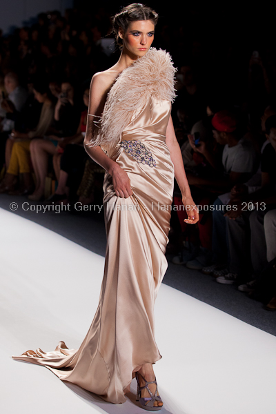 A model on the runway at the Venexiana SS2013 show at New York Mercedes-Benz Fashion Week.
