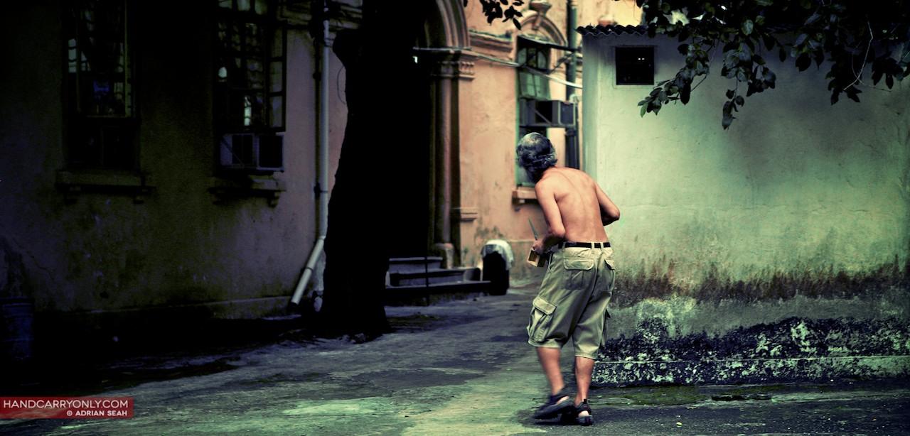 topless man looking round the corner hong kong