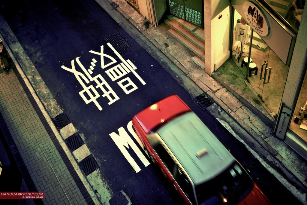 taxi with slow sign hong kong