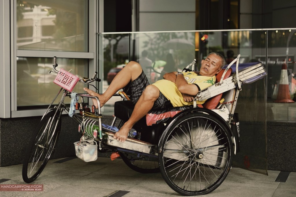 man sleeping on the trishaw singapore