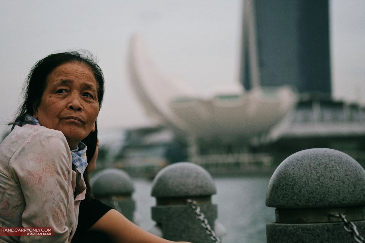 old lady by the singapore river