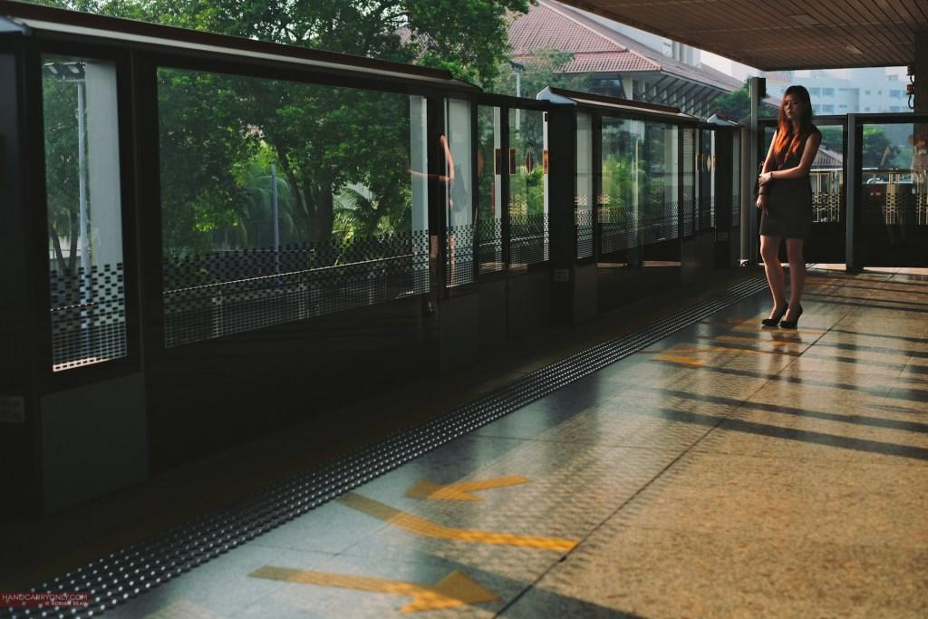 girl waiting for train singapore