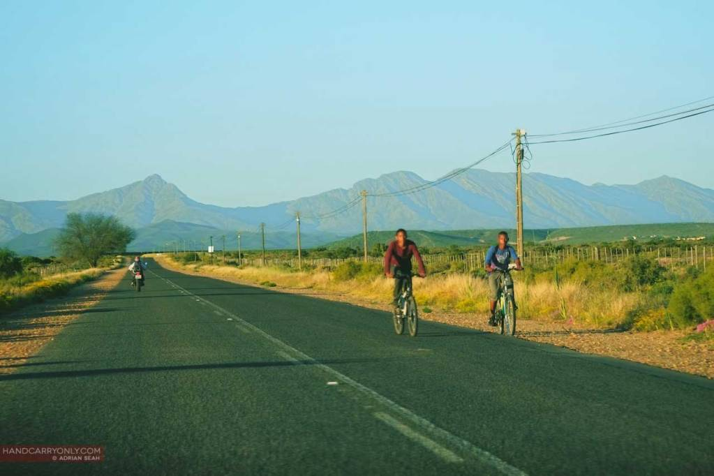 Cyclist on open road in South Africa