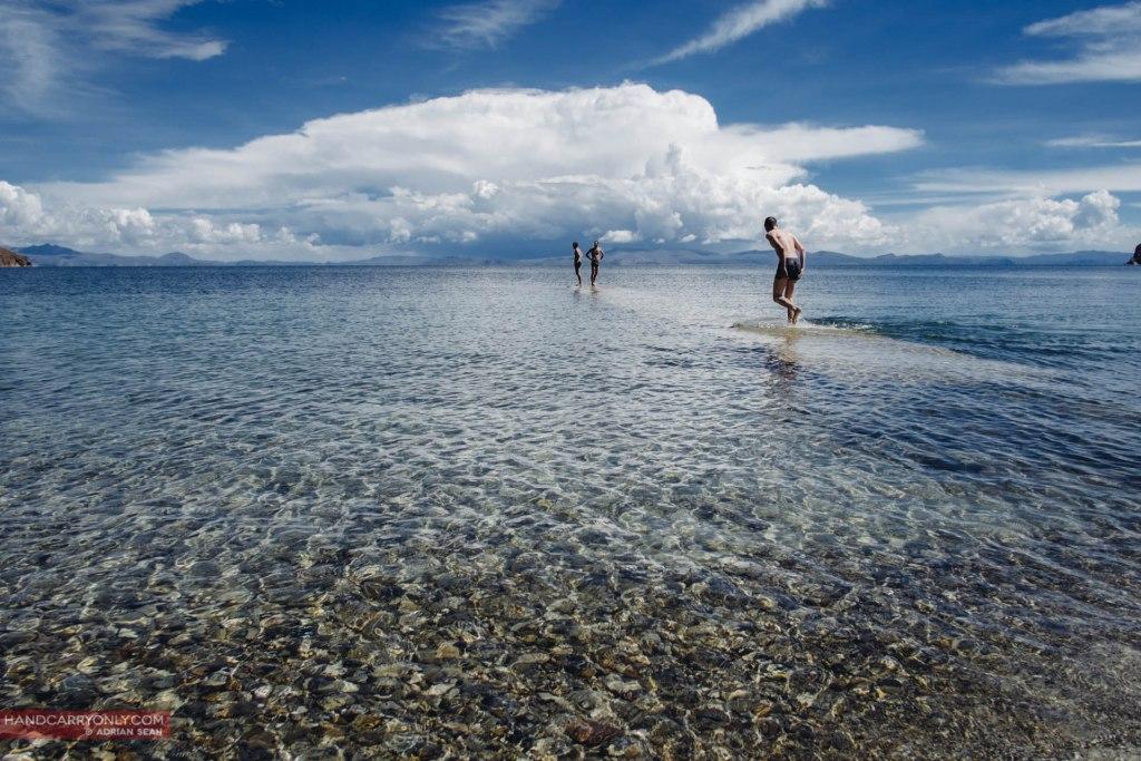 guys running on water lake titicaca bolivia