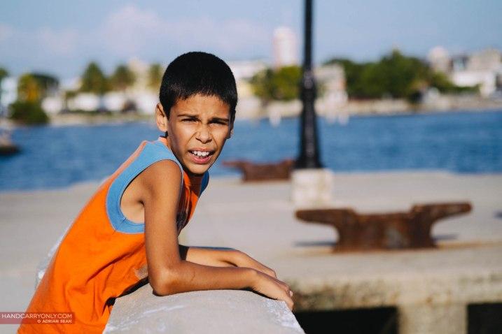 cuban boy at malecon