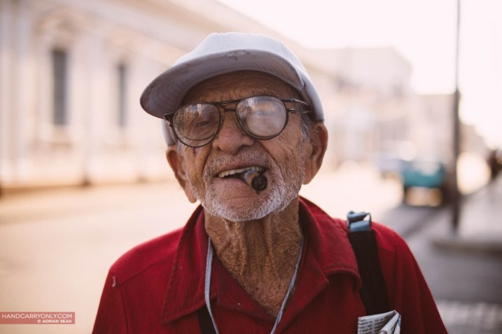 Old cuban man with cigar and funny glasses