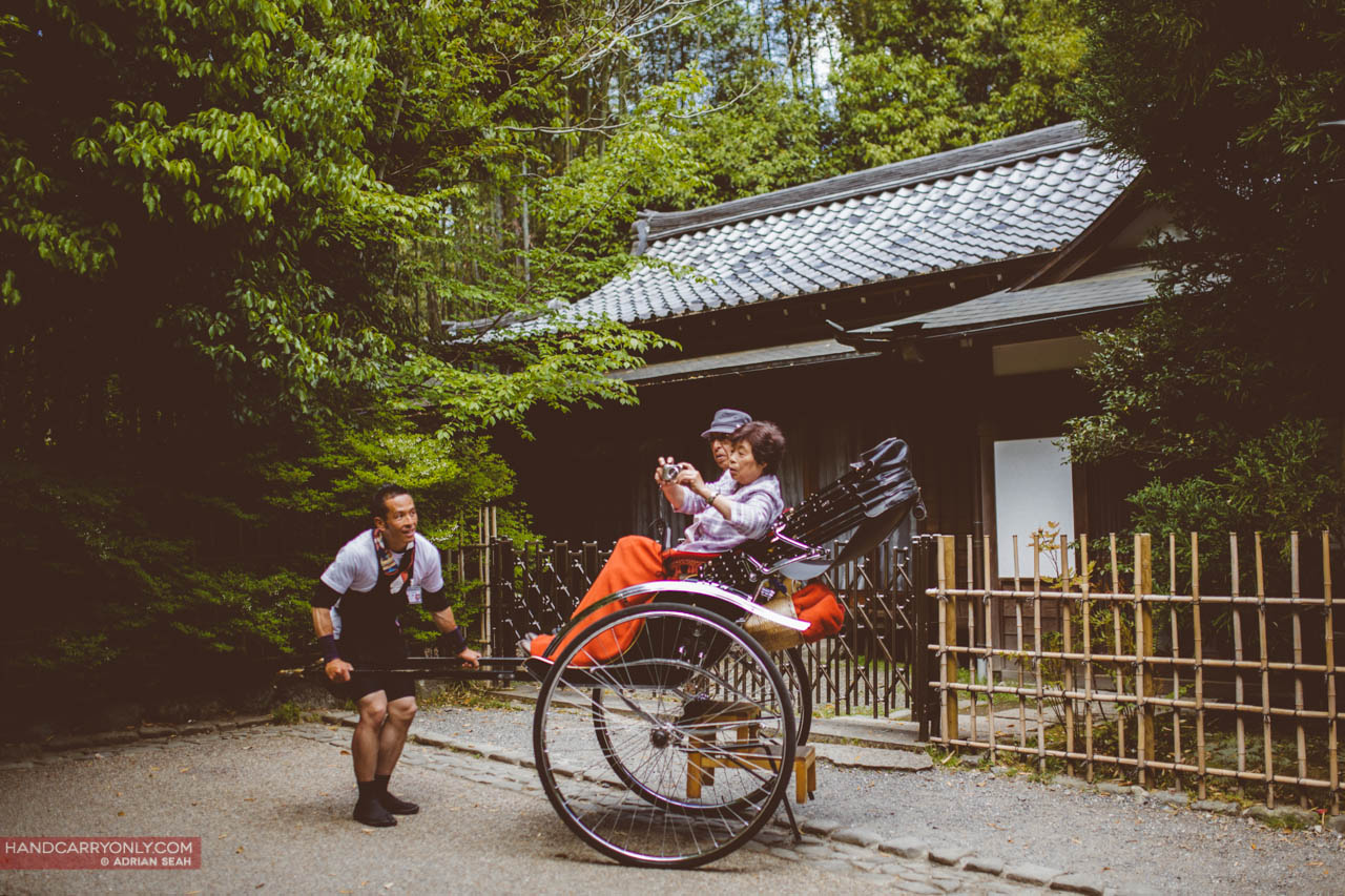 rickshaw in front of temple arashiyama kyoto japan