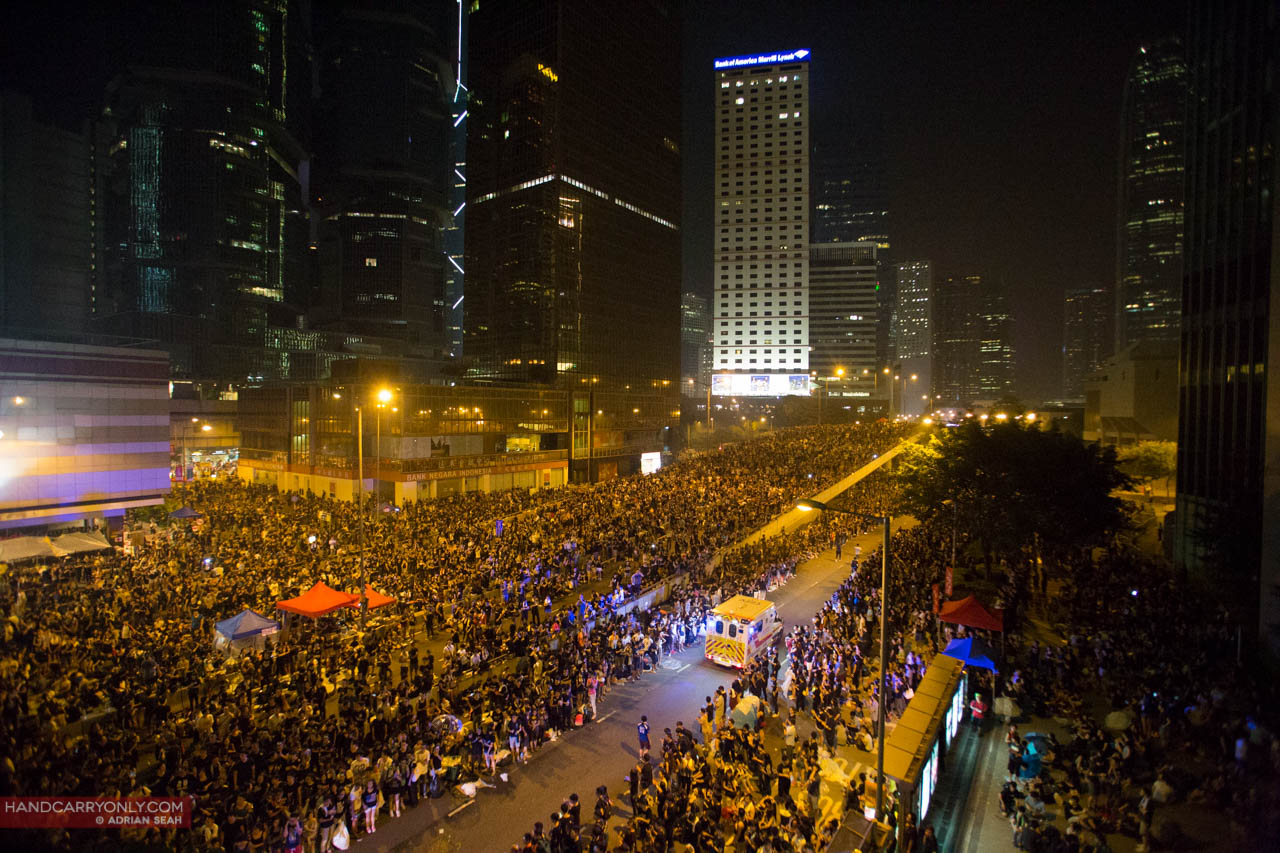 crowd parting way for ambulance occupy central
