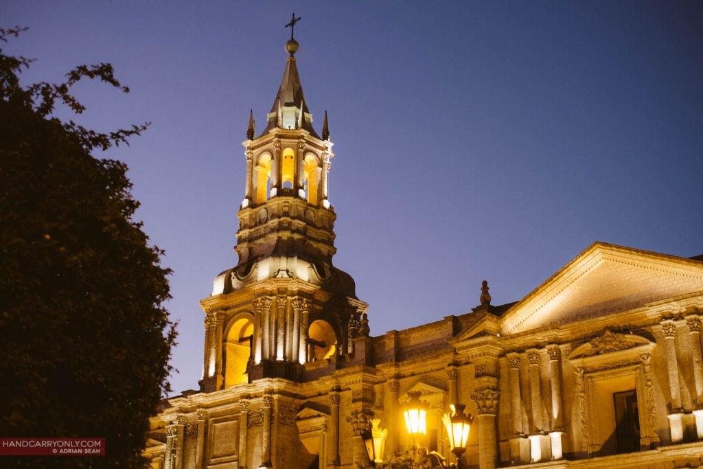 The arequipa cathedral lit up at dusk