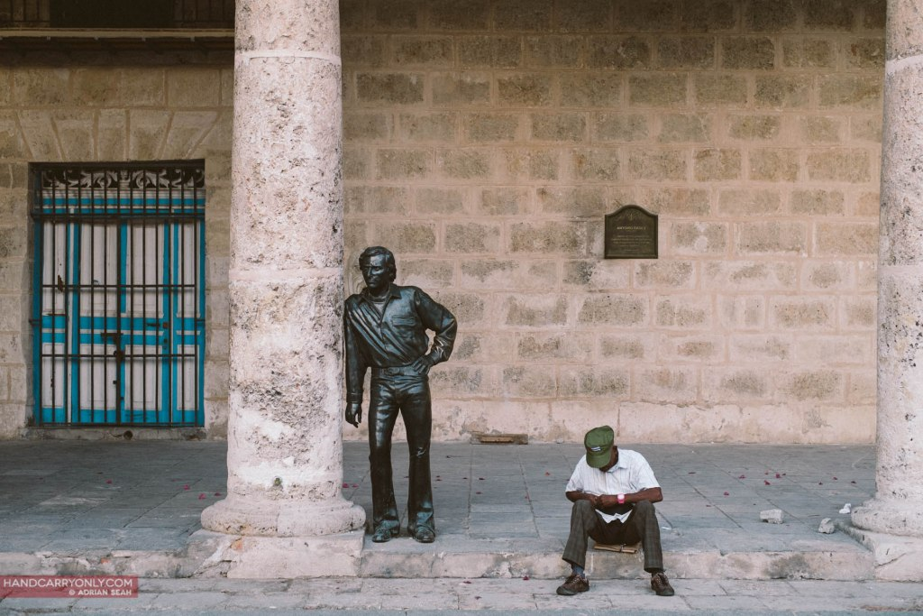 A man resting next to the statue of famous Spanish dancer Antony Gades in la Plaza de la Cathedral, Havana Cuba