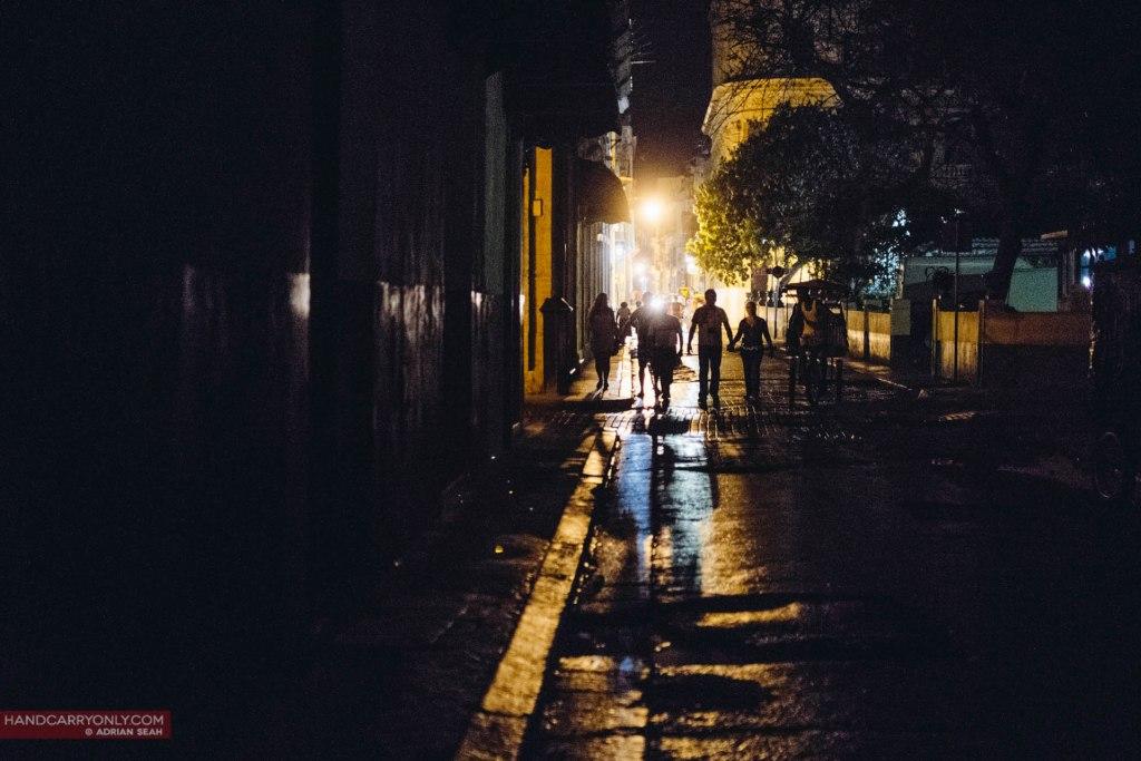 people on the streets at night havana cuba