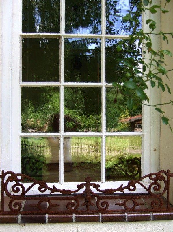 Tags  decoratie antiek  venster grille  rond de