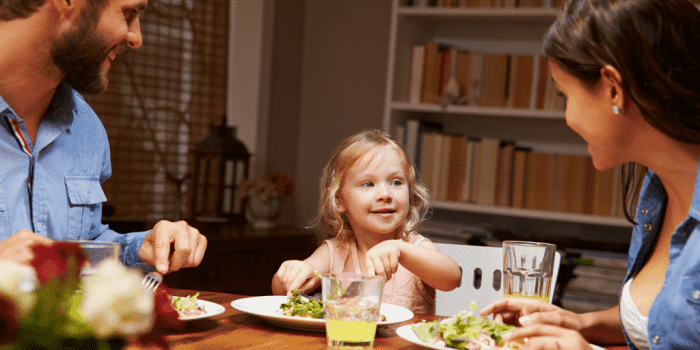 a father, daughter and mom eating at dinner time in a post about avoiding dinner time battles