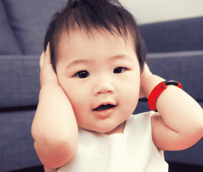 baby with hands in his ears in podcast about getting kids to listen