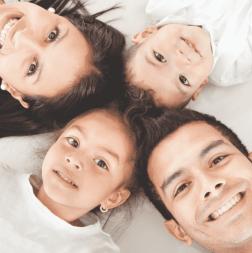 Family lying looking at camera