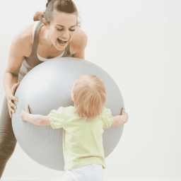mom working out with exercise ball and a baby