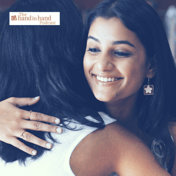 Two moms hugging and smiling, giving support