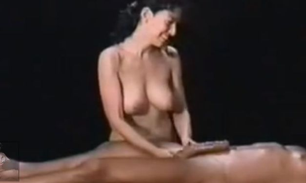 Hot busty brunette takes her time giving him a handjob