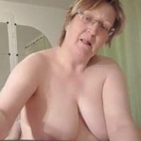 Busty Grandma gives a hot handjob