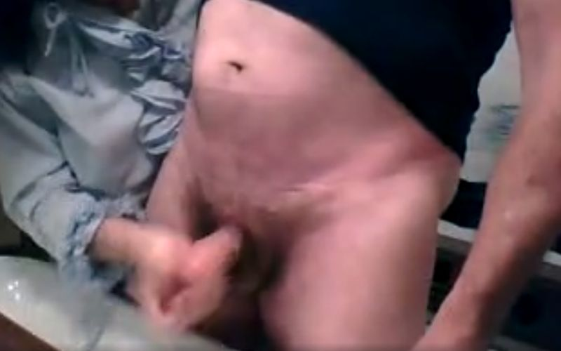 Granny gives him a quick handjob and let him cum in the sink