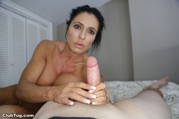 Busty older woman jerks off his big cock