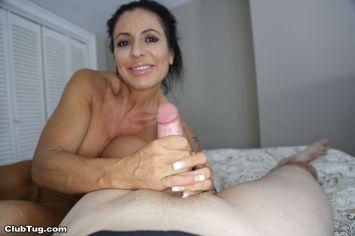 busty-older-woman-jacks-off-a-big-cock-02