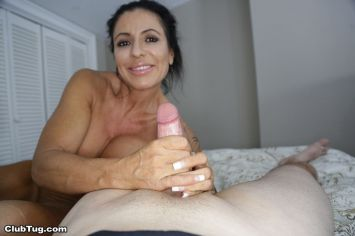 busty-older-woman-jacks-off-a-big-cock-02