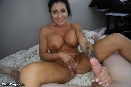 busty-older-woman-jacks-off-a-big-cock-10