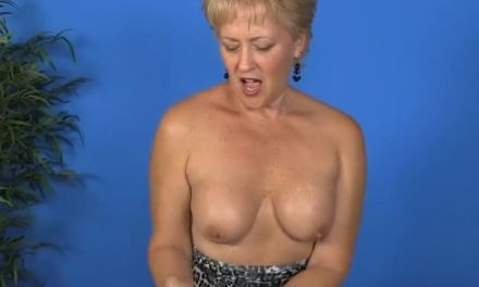 Mature blonde with big tits gives a massage and a handjob