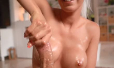 Busty blonde gives him a slow edging handjob