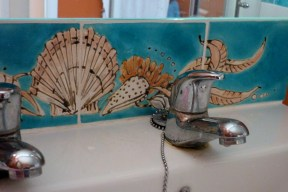 shell splashback bathroom tiles.