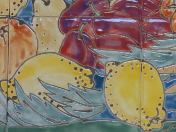 handmade tiles with fruit still life, detail