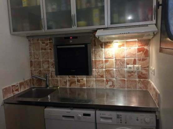 Agate ware handmade tiles in a studio kitchen.