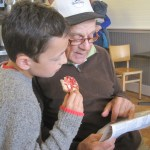 Boy and Grandpa reading newspaper