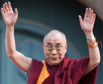The Dalai Lama: hands up.