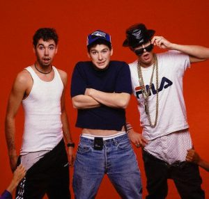 1987 --- Women's hands pull the pants off members of the Beastie Boys rap group. --- Image by © Lynn Goldsmith/CORBIS