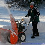Man with large snowblower