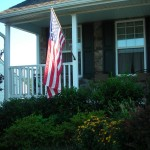 Solar spots lighting the flag on the porch