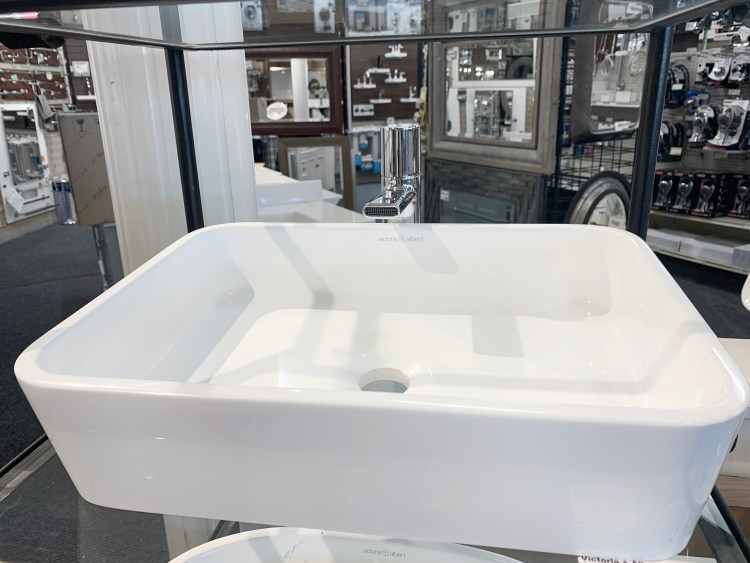 Rectangular white vessel sink